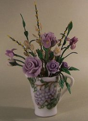 Purple Roses in a China Pitcher