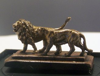 Pair of African lions on wood base.