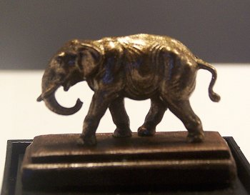 Elephant Statue on Wood Base