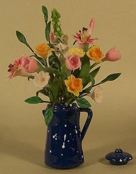 Mixed Spring Flowers in Blue Coffee Pot