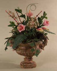 Pink Hibiscus and ferns in an Aged Urn
