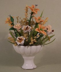 Yellow Lilies in a White Pedestal Vase