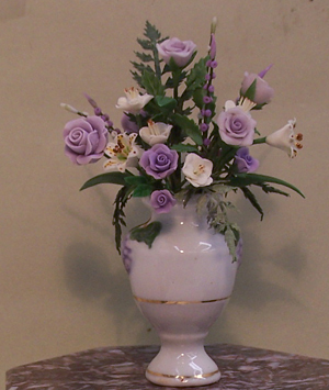 Purple Roses in White China Vase